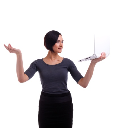 Young business woman time management laptop on hands isolated photo
