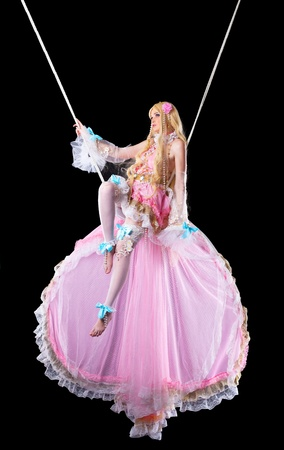 cosplay: Pretty girl in fary-tale doll costume fly on wire