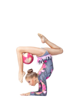 string bikini: Young girl stand on hands with acrobatics ball isolated Stock Photo