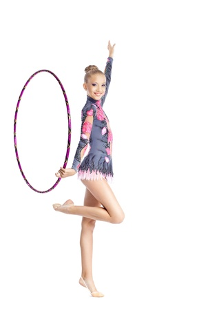 string bikini: Young teenager girl doing gymnastics exercise with hoop isolated