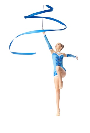 string bikini: Young teenager girl doing gymnastics exercise with blue ribbon isolated Stock Photo