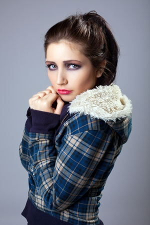 Beautiful grunge sexy woman in jeans jacket look with sad photo