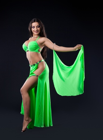 beauty young woman dance in green veil arabic oriental style costume
