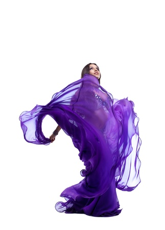 beauty young girl dance in purple arabic oriental costume with flying veil isolated Stock Photo - 10748428