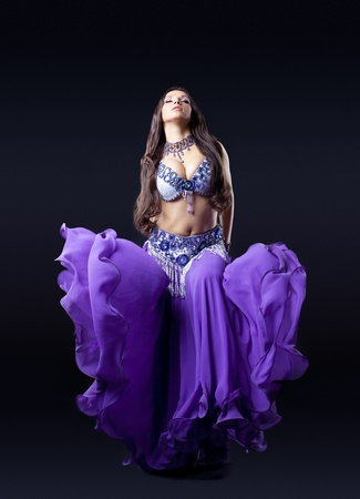 beauty young girl dance in dark with fly purple veil Stock Photo - 10748435