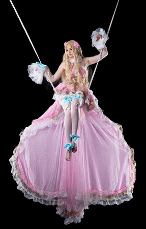 Young girl in fary-tale doll cosplay costume fly on wire photo