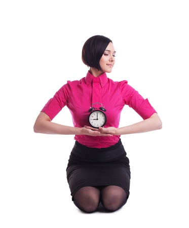 young woman in business suit sit in yoga pose with clock relaxed isolated photo