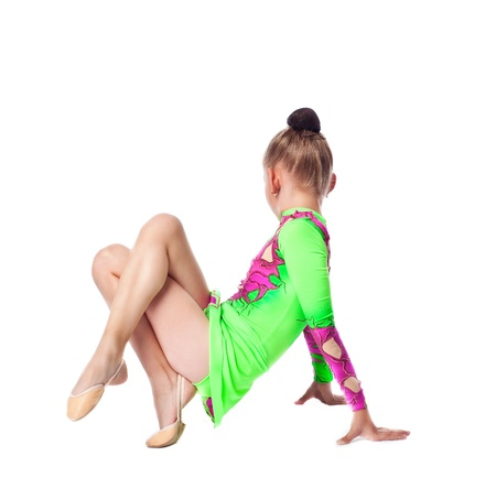 young gymnast girl in green sit on white isolated Stock Photo - 10787911