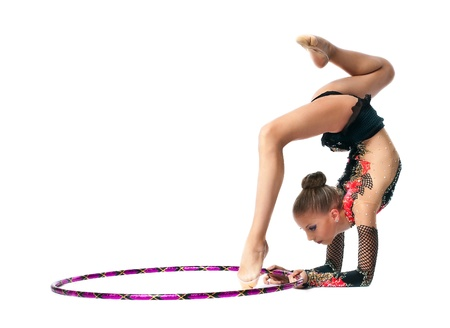 female gymnast: Young teenager girl stand on hands with hoop isolated Stock Photo