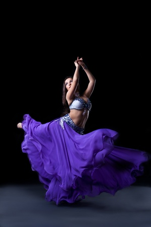 beauty young girl dance in dark with fly purple veil Stock Photo - 10787924