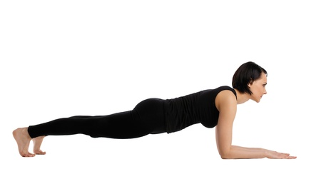 young woman training in yoga - Downward Facing Dog stand pose photo