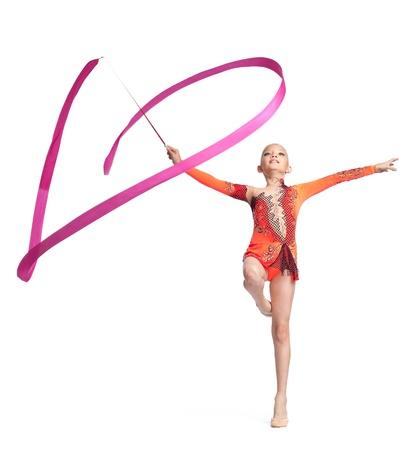 string bikini: Young teenager girl doing gymnastics exercise with red ribbon