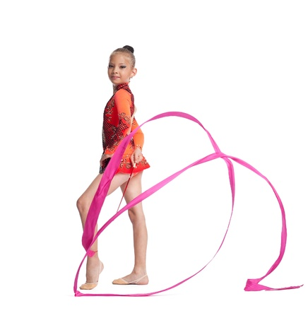 female gymnast: Young teenager girl doing gymnastics exercise with red ribbon isolated