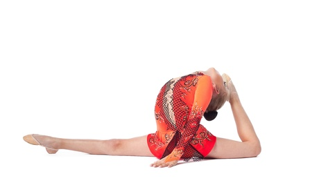 beautiful girl sits on a splits - look at camera isolated photo
