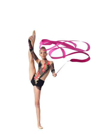 string bikini: Young teenager professional gymnast stand on splits with ribbon