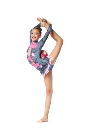 Young beautiful girl  professional gymnast stand on a splits - look at camera isolated
