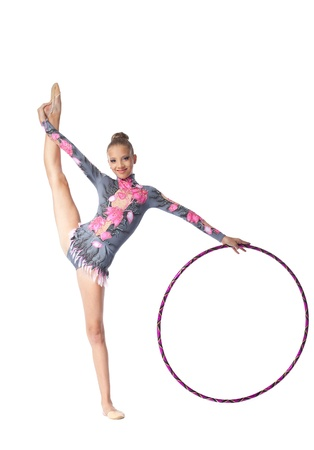 string bikini: Young beautiful girl  professional gymnast stand on a splits  with hoop