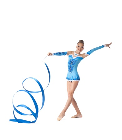 Young teenager girl doing gymnastics exercise with blue ribbon isolated Standard-Bild