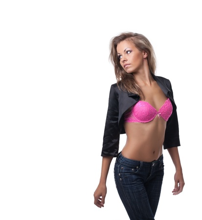 young girl nude: Sexy young woman posing in rose bra and black jeans and jacket