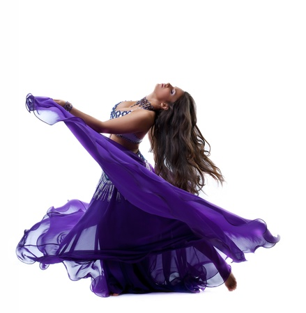 beauty young girl dance in purple arabic oriental costume with flying veil isolated Standard-Bild