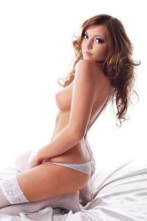 Beautiful sexy woman lay in lingerie on white silk Stock Photo - 11041429
