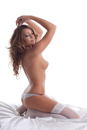 Beautiful sexy woman lay in lingerie on white silk Stock Photo - 11041426
