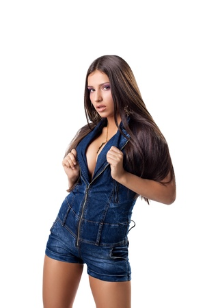 Sexy young girl with huge breast posing in jeans costume isolated photo