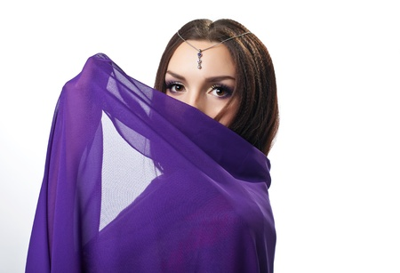 indian saree: Beauty woman close face by purple cloth with jewels on head