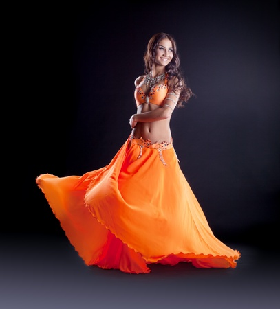 perfect young girl dance in orange veil arabic style costume photo