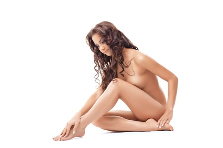 feet naked: beautiful young bare woman sit on leg studio portrait isolated