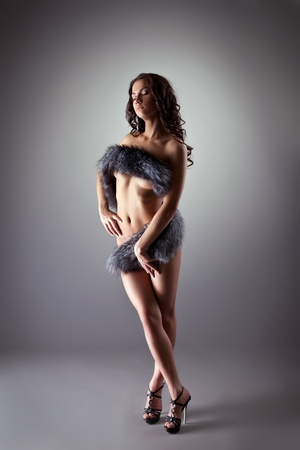 Beauty nude girl posing in fur coat  photo