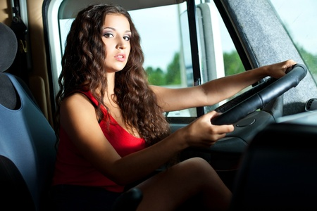 Young attractive girl drive big truck in summer evening Stock Photo - 11566788