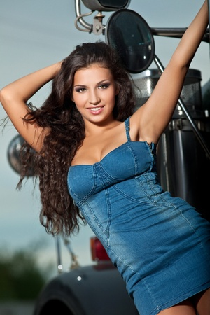 Young sexy girl portrait near steel truck at night