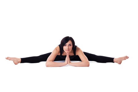 woman sit in yoga asana - doing split isolated - Wide-Angle Seated Forward Bend photo