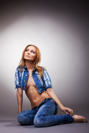 Sexy woman sit in jeans and jacket on naked body Stock Photo - 11566859
