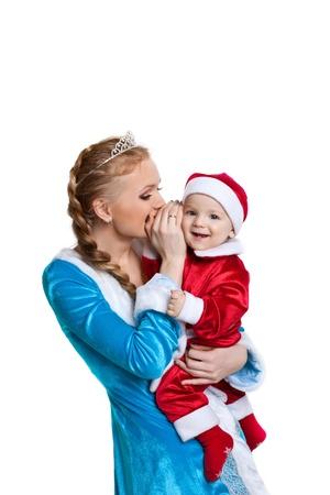 Beautiful christmas girl talk a secret to happy baby santa claus smile  photo
