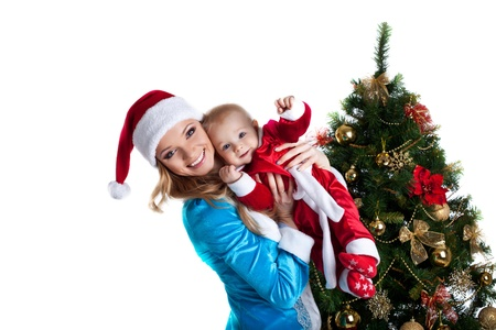 Beauty christmas girl in blue play with baby santa claus  photo