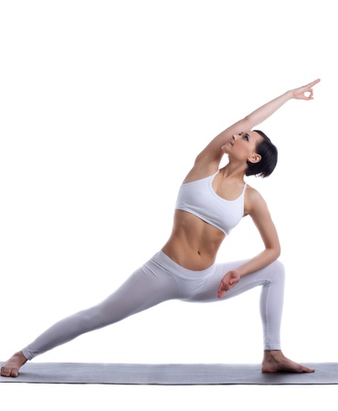 young woman training in yoga pose isolated photo