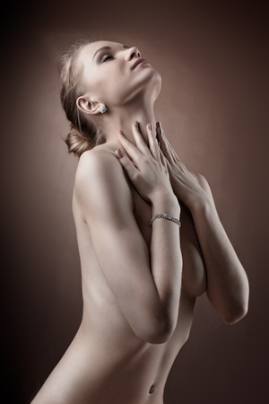 young girl nude: Amazing naked woman studio portrait hide breast with hands