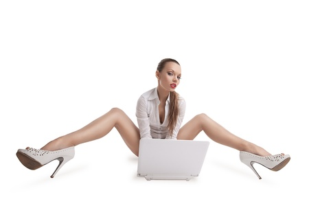 sexy young woman sit with laptop and beauty long legs Stock Photo