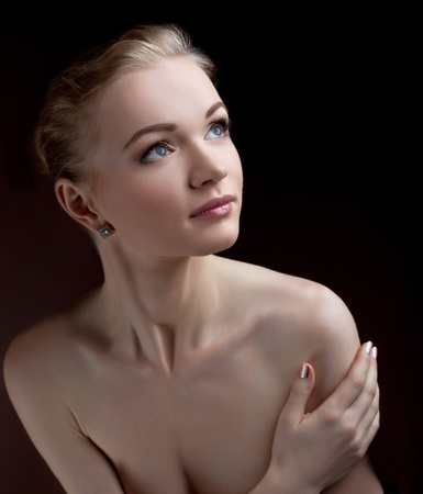 nude woman posing: Amazing naked woman studio portrait hide breast with hands