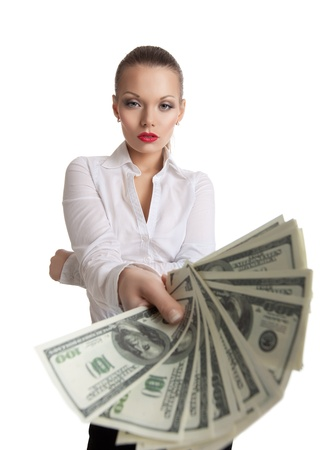 young business woman offer to you a bundle of dollars isolated Stock Photo - 11791444