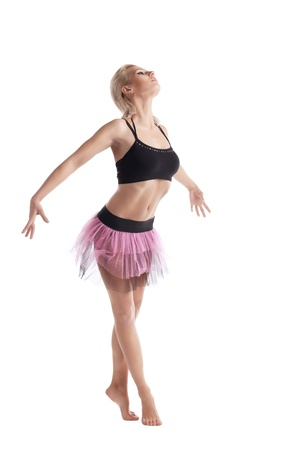 Athletic beauty young woman posing in dance sport costume isolated Stock Photo - 11791521