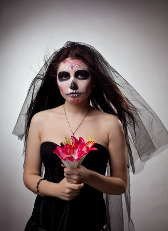 Young woman wearing with roses dressed up for All Souls Day with flowers