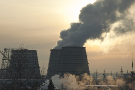 energy station with smoke at winter sunset in Russia photo