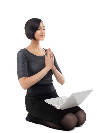 Young businesswoman sit on white with laptop isolated photo