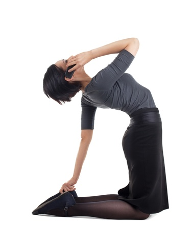 Young business woman in yoga pose with cell phone on hands isolated photo