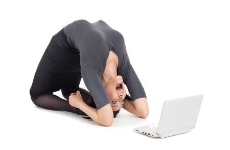 phone the clock: Young crazy businesswoman in yoga pose cry on laptop isolated Stock Photo
