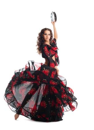 tambourine: Giovane donna in costume da ballo bellezza gitana con tamburello isolato