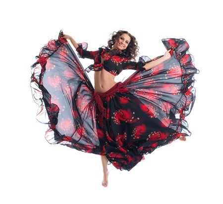 young Beauty woman jump in gypsy dance isolated photo